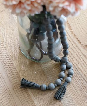 Picture of Distressed Wooden Bead Garland With Tassels